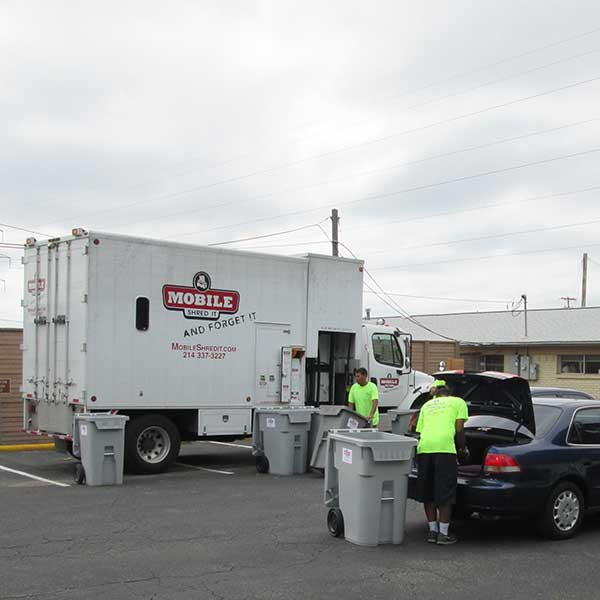 Secure shredding truck accepting materials from Irving residents.