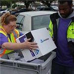 Irving Solid Waste Services staff collect sensitive documents for secured shredding at a community e