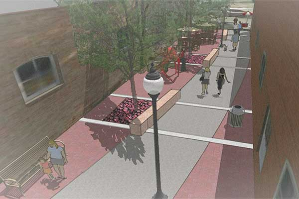 Architectural rendering of the Main Street Plaza, showing the interior path and seating.