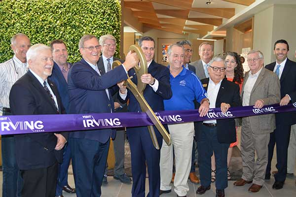 Mayor Rick Stopfer, along with Westin executives and other city officials, cut the ribbon and open t