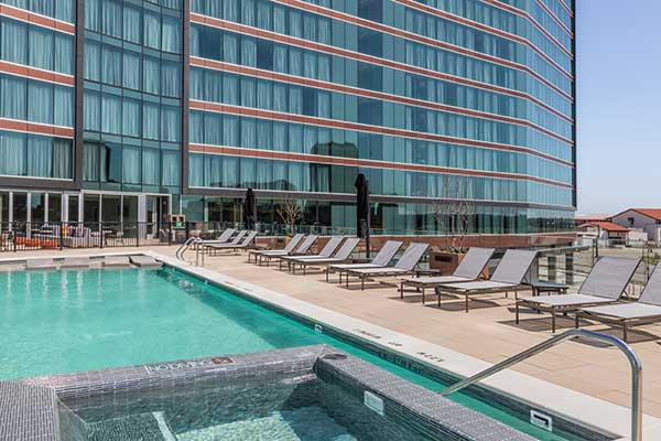 Pool and surrounding deck of the Westin Irving Convention Center Hotel.