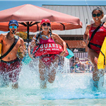 Irving lifeguards running into West Irving Aquatic Center's pool.