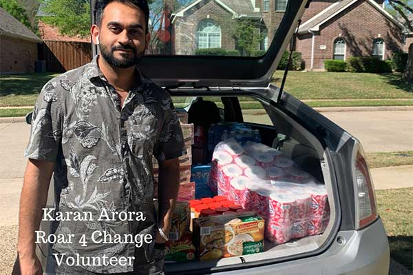 Roar 4 Change volunteer with a trunk full of groceries to deliver.