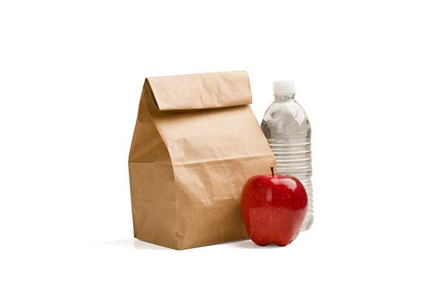Sack lunch with apple and water.