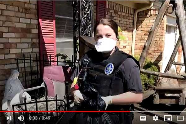 Irving Animal Services Officer delivers pet food to residents during the COVID-19 pandemic.