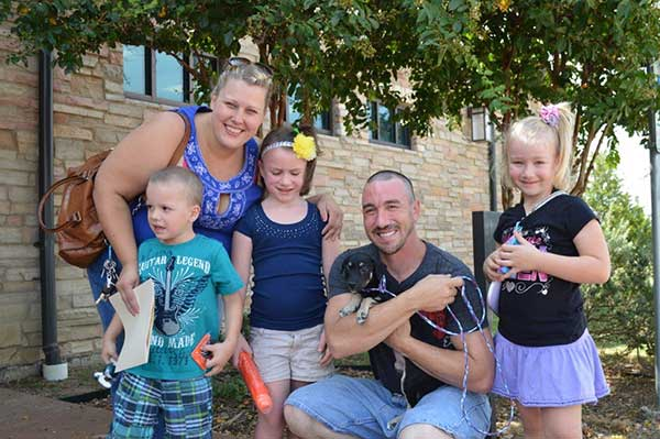 One puppy found his forever home with this lucky family at Irving's Empty the Shelter Event.