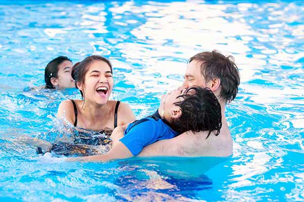 Family with special needs child enjoy pool time away from the crowds.